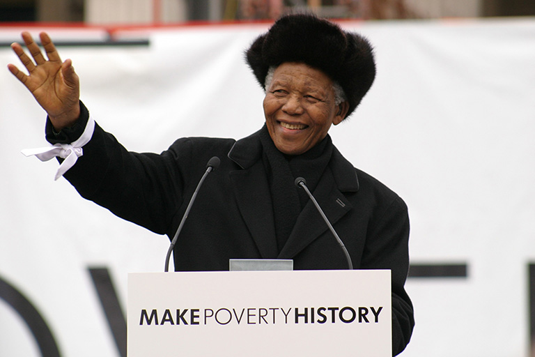 Nelson Mandela addresses over 22,000 people in Trafalgar Square on behalf of the MAKEPOVERTYHISTORY coalition. He hands a group of school children his white band to be delivered with thousands of others to the leaders of the G8.